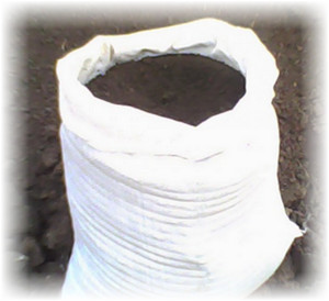 белый мешок с землей